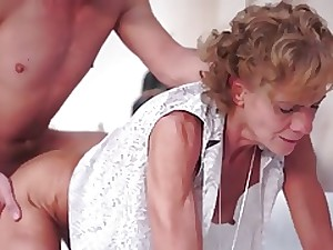 Slim granny drilled by a youthful man